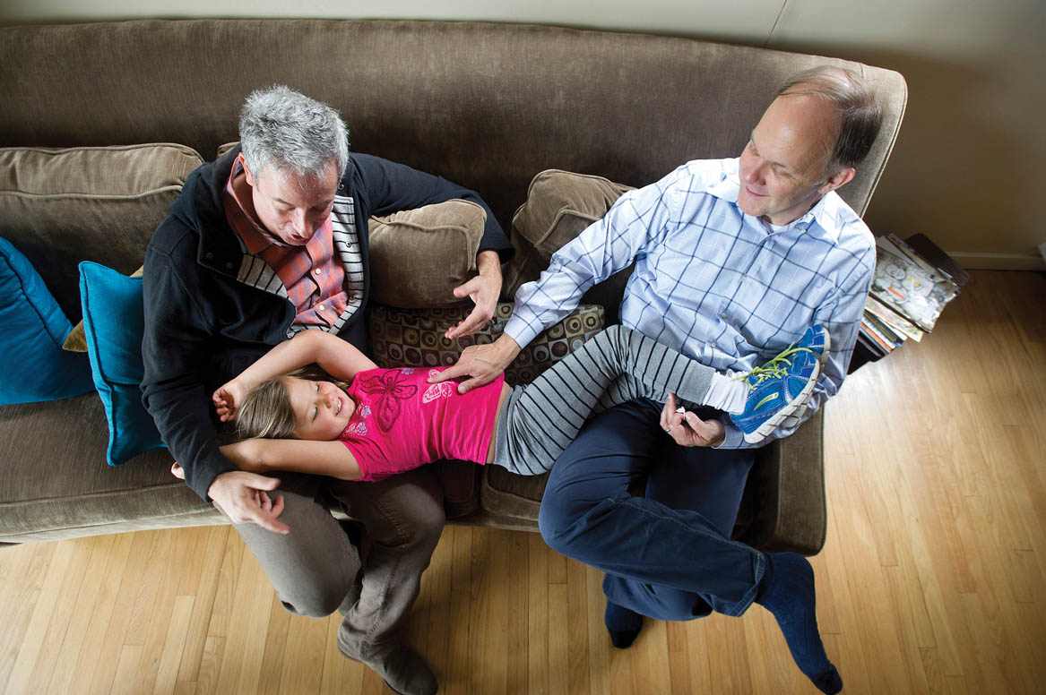 Ellie Mowry-Silverman, 6, spends time with her dads Rev. Paul Mowry, right, and Joe Silverman at their home in Sausalito
