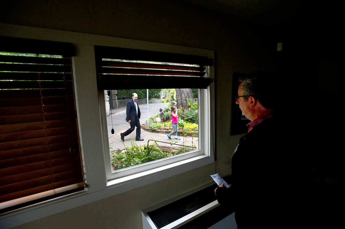 Joe Silverman watches as his same-sex partner Rev. Paul Mowry and their daughter Ellie Mowry-Silverman, 6, return from a church errand in Sausalito