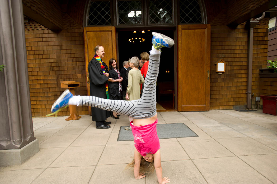 Ellie Mowry-Silverman, 6, does a cartwheel outside Sausalito Presbyterian Church while her dad Rev. Paul Mowry greets parishioners after Sunday service in Sausalito